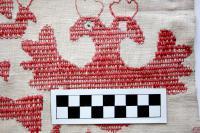 Фрагмент. Конец полотенца. XIX век. Холст, вышивка, ручная работа. 35,5х42,5 см. Инв. № М-22318. Вид после реставрации. Из собрания Н.Г. Добрынкина