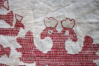 Фрагмент. Конец полотенца. XIX век. Холст, вышивка, ручная работа. 35,5х42,5 см. Инв. № М-22318. Вид до реставрации. Из собрания Н.Г. Добрынкина